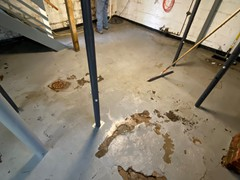 This basement floor had cracks and damage from years of wear and tear