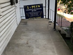 This porch needed power washing, crack repair, and rebuilt where some places crumbled